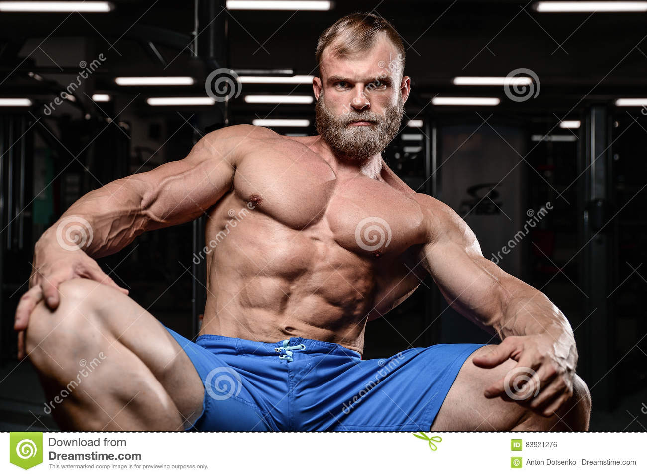 Brutal muscular man with beard unshaven fitness model healthcare