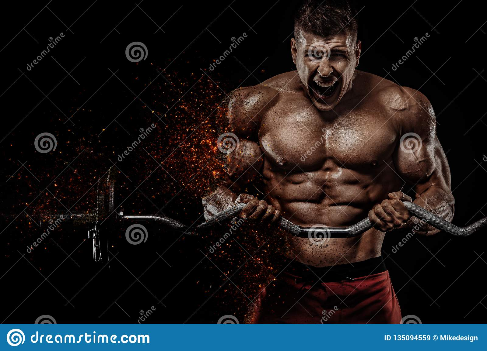 Brutal strong muscular bodybuilder athletic man pumping up muscles with barbell on black background. Workout