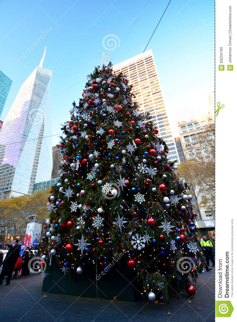 new york usa december 3 2015 ice skating in bryant park ice rink with view of christmas tree and people
