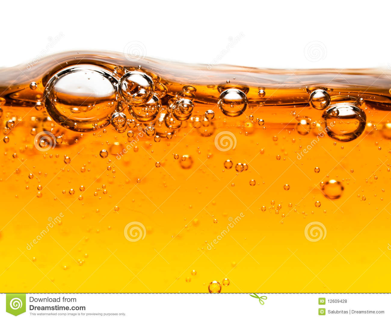 Bubbles In Orange Liquid Soap Royalty Free Stock Photos
