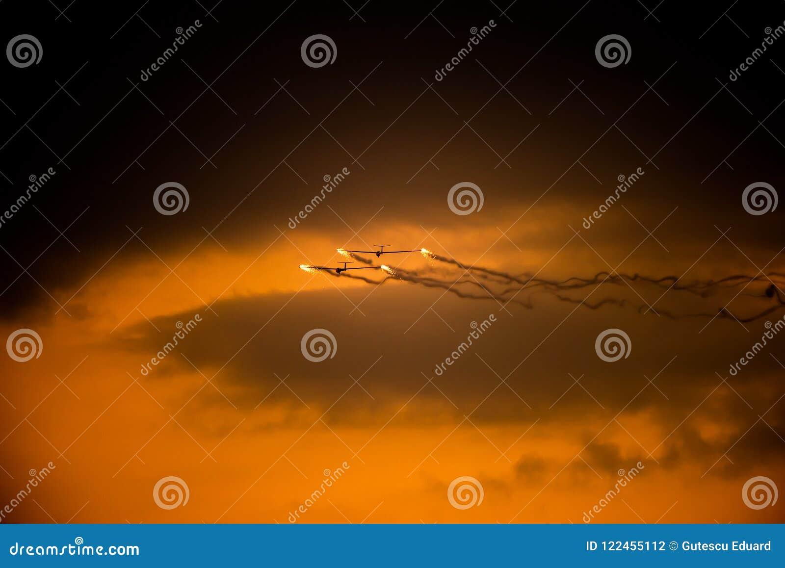 Bucharest international air show BIAS, air glider duo aerobatic team silhouette