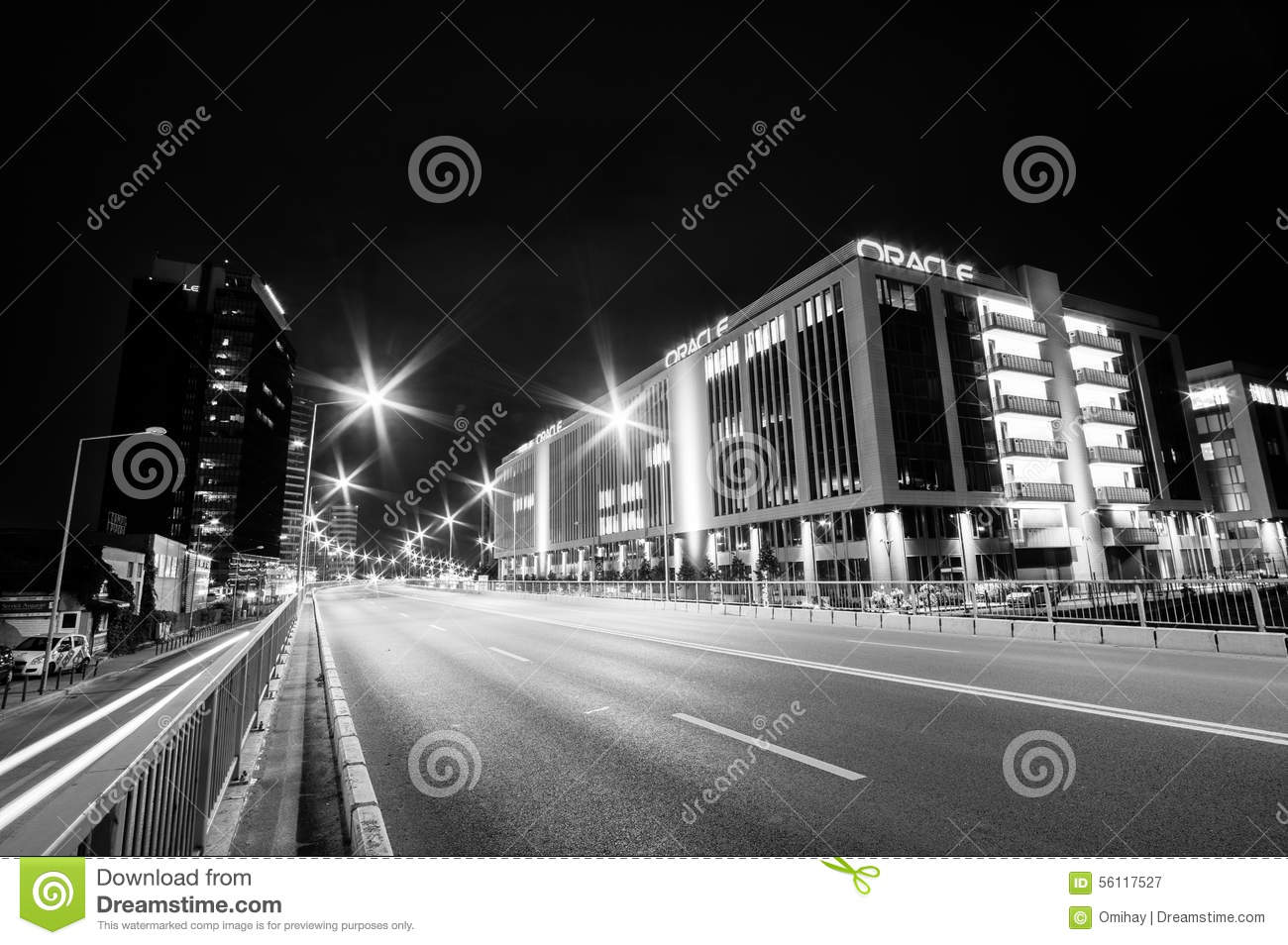 Bucharest, Romania, June 28, 2015 - Business architecture at night - skyscrapers and street lights- in black and white