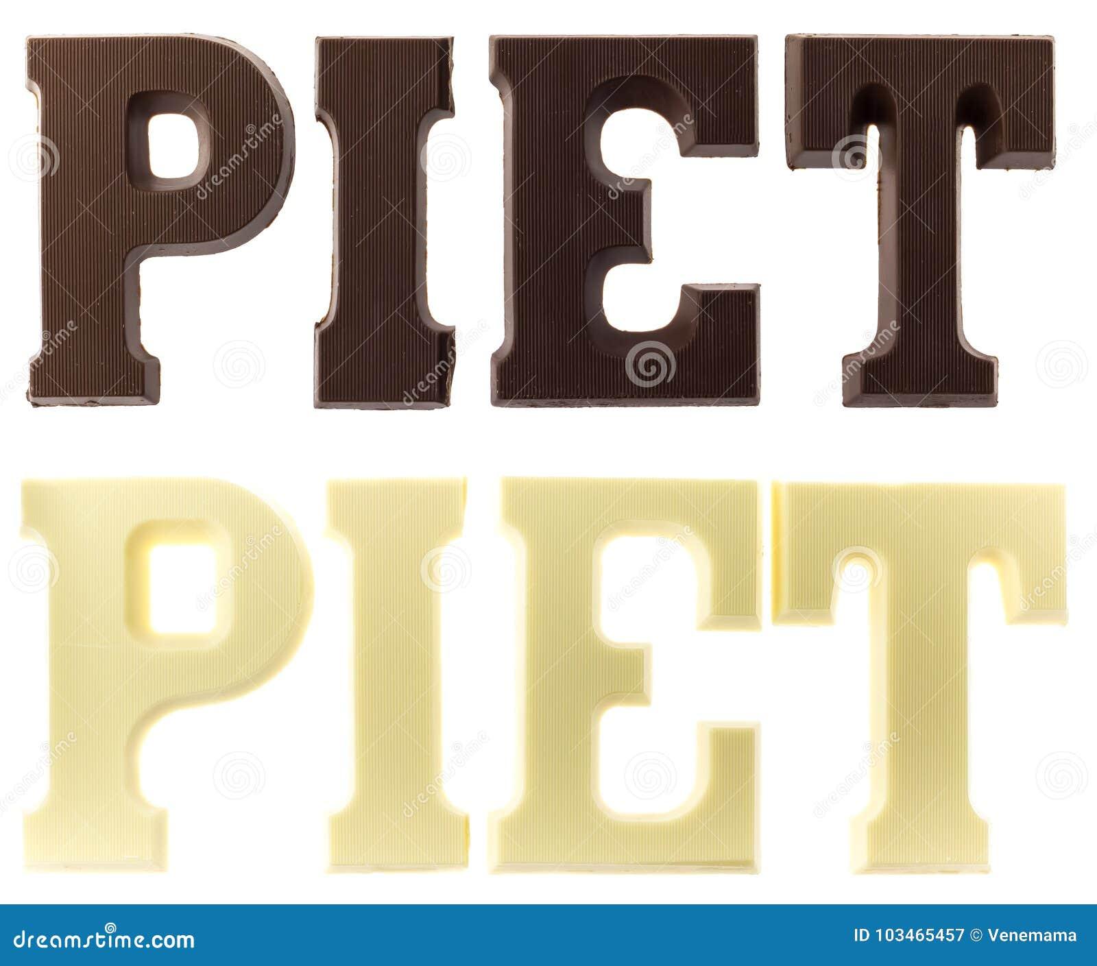 Buchstaben in der dunklen und weißen Schokolade, die den Namen schwarzen P buchstabiert