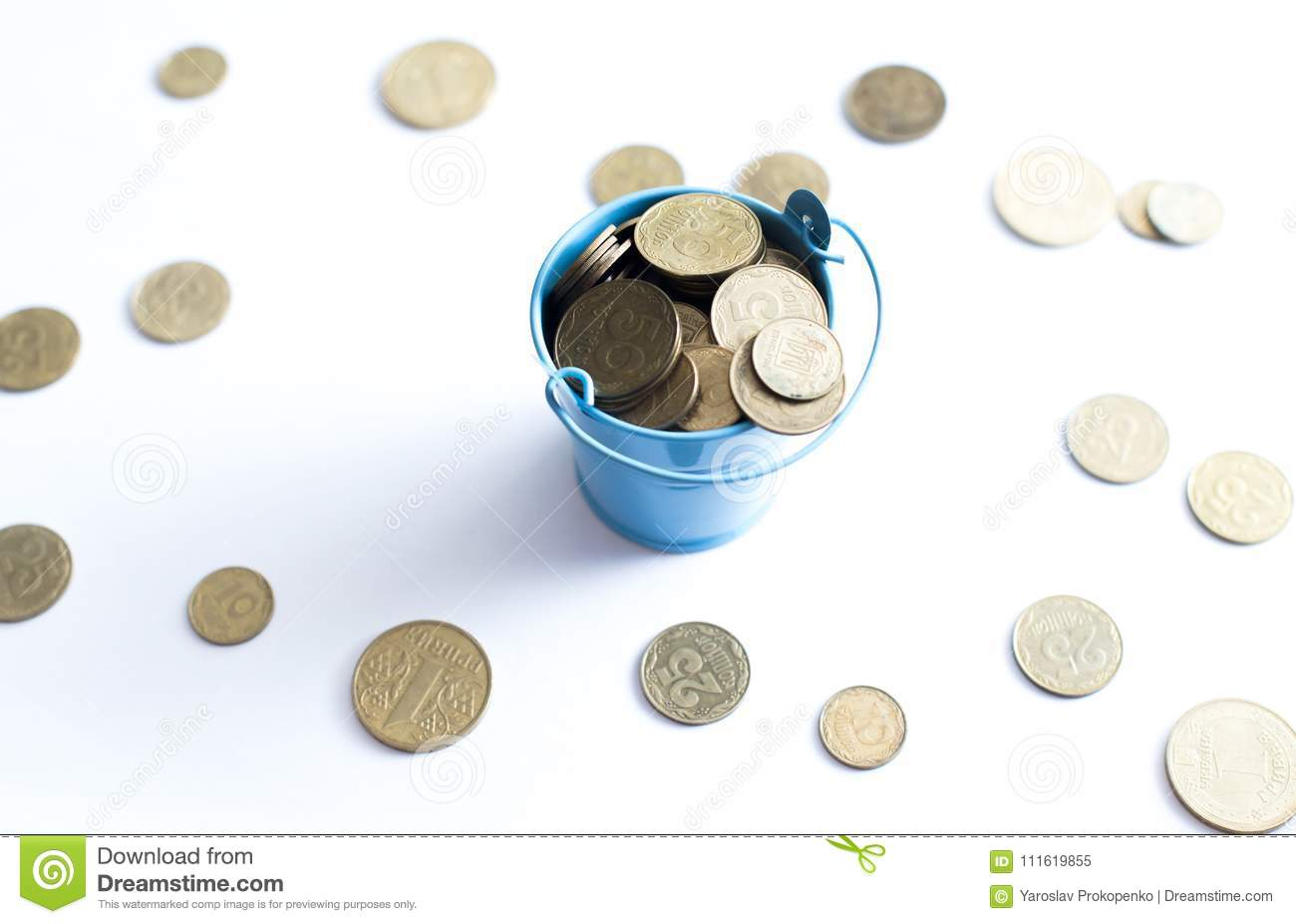 A bucket with coins on a white background is isolate. Business concept