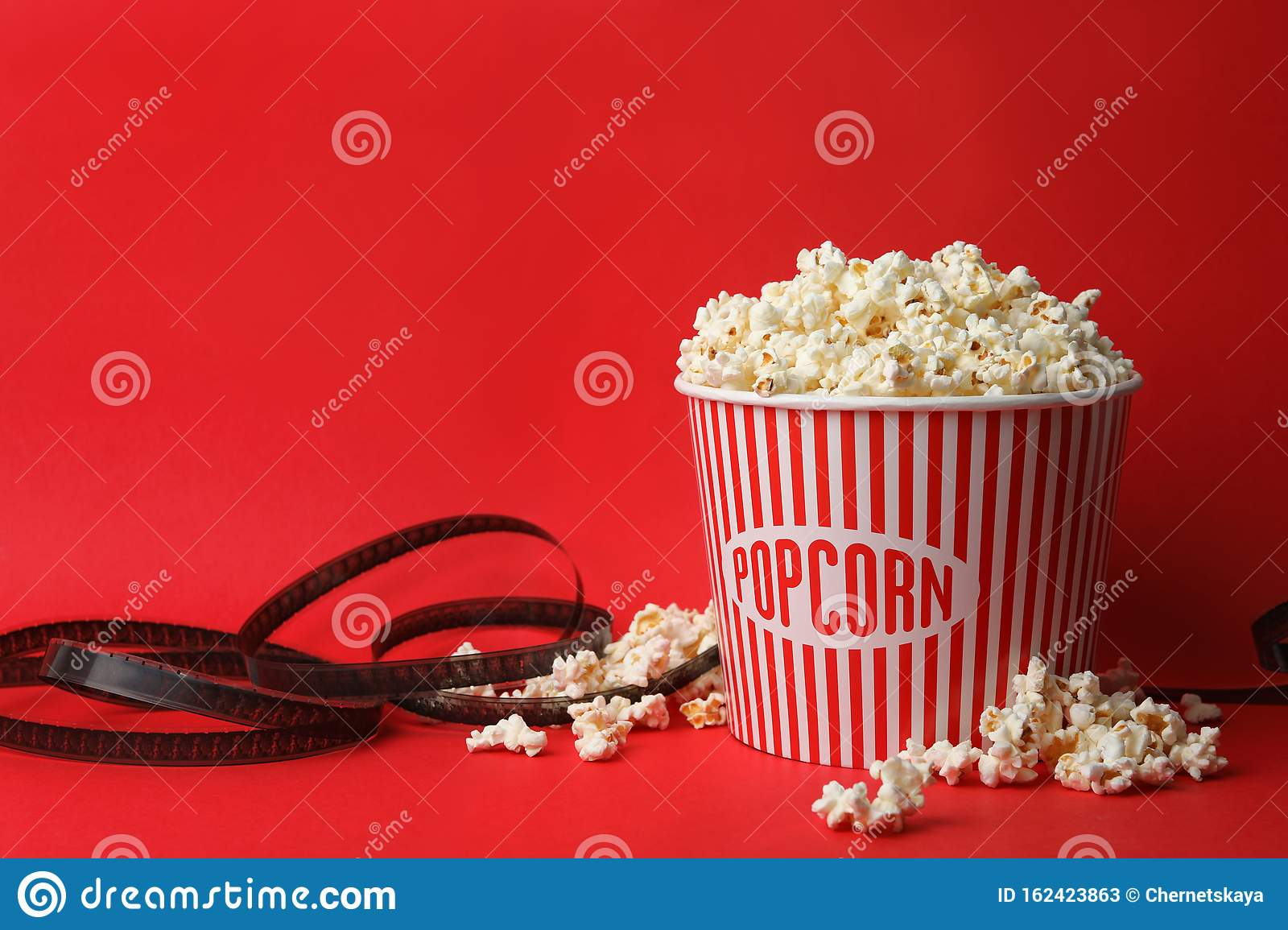 Bucket Of Fresh Popcorn And Film Footage On Background Space For Text Cinema Snack Stock Image Image Of Cinematography Space 162423863