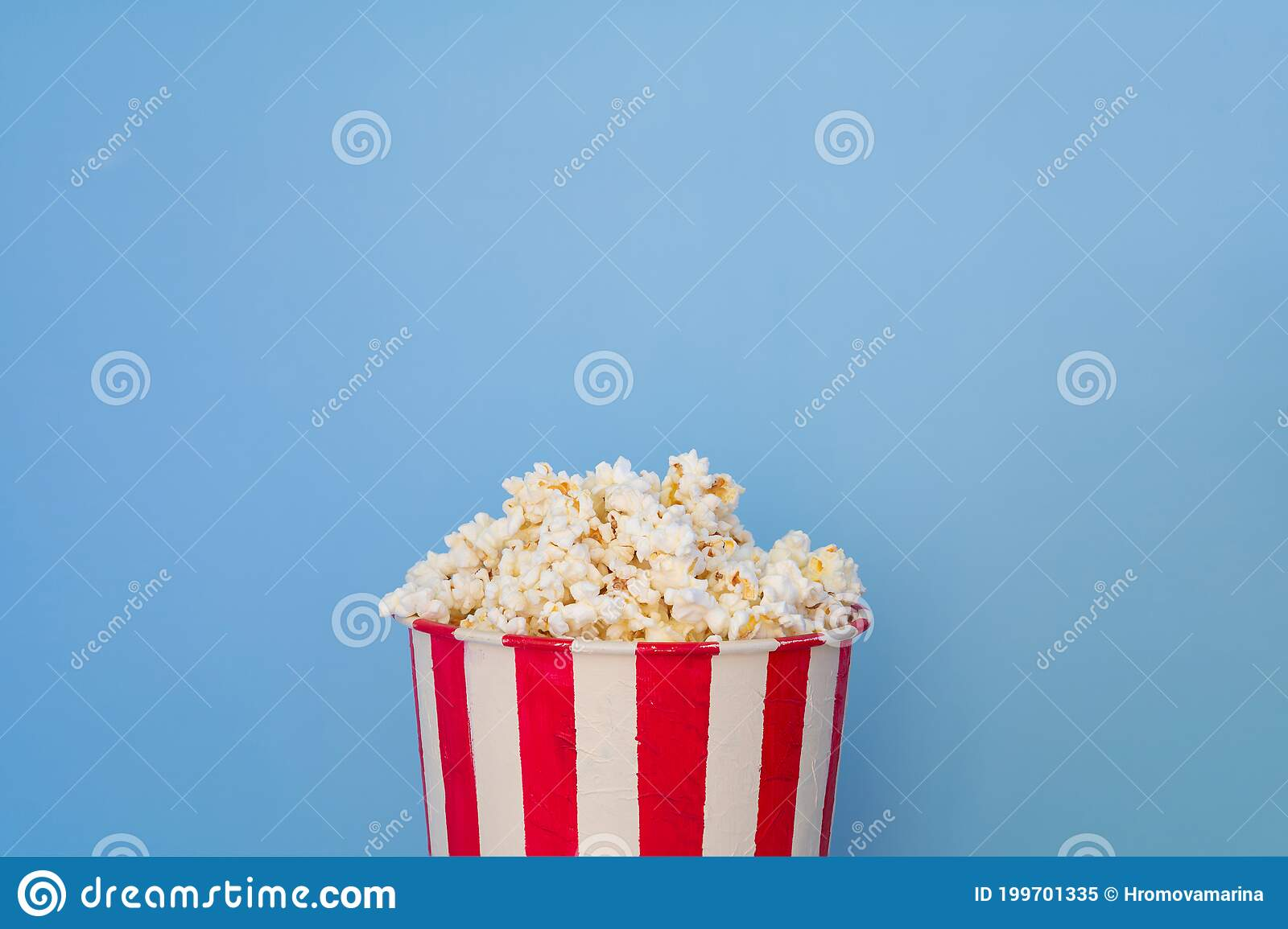 A Bucket Full Of Popcorn On A Blue Background Stock Image Image Of Delicious Closeup 199701335