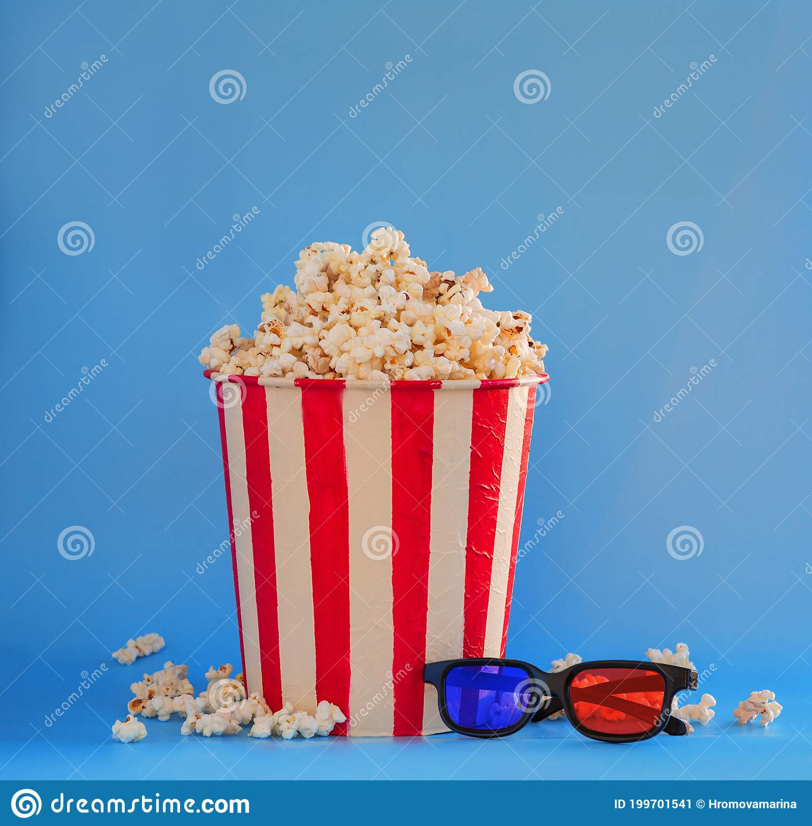 A Bucket Full Of Popcorn On A Blue Background And 3d Glasses Stock Image Image Of Refreshment Fastfood 199701541
