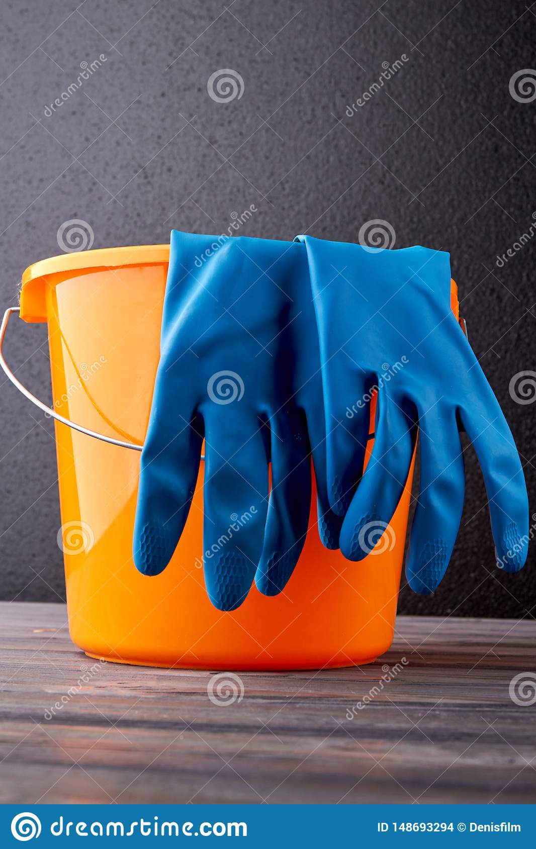 Bucket And Gloves For Cleaning On Dark Background. Stock ...