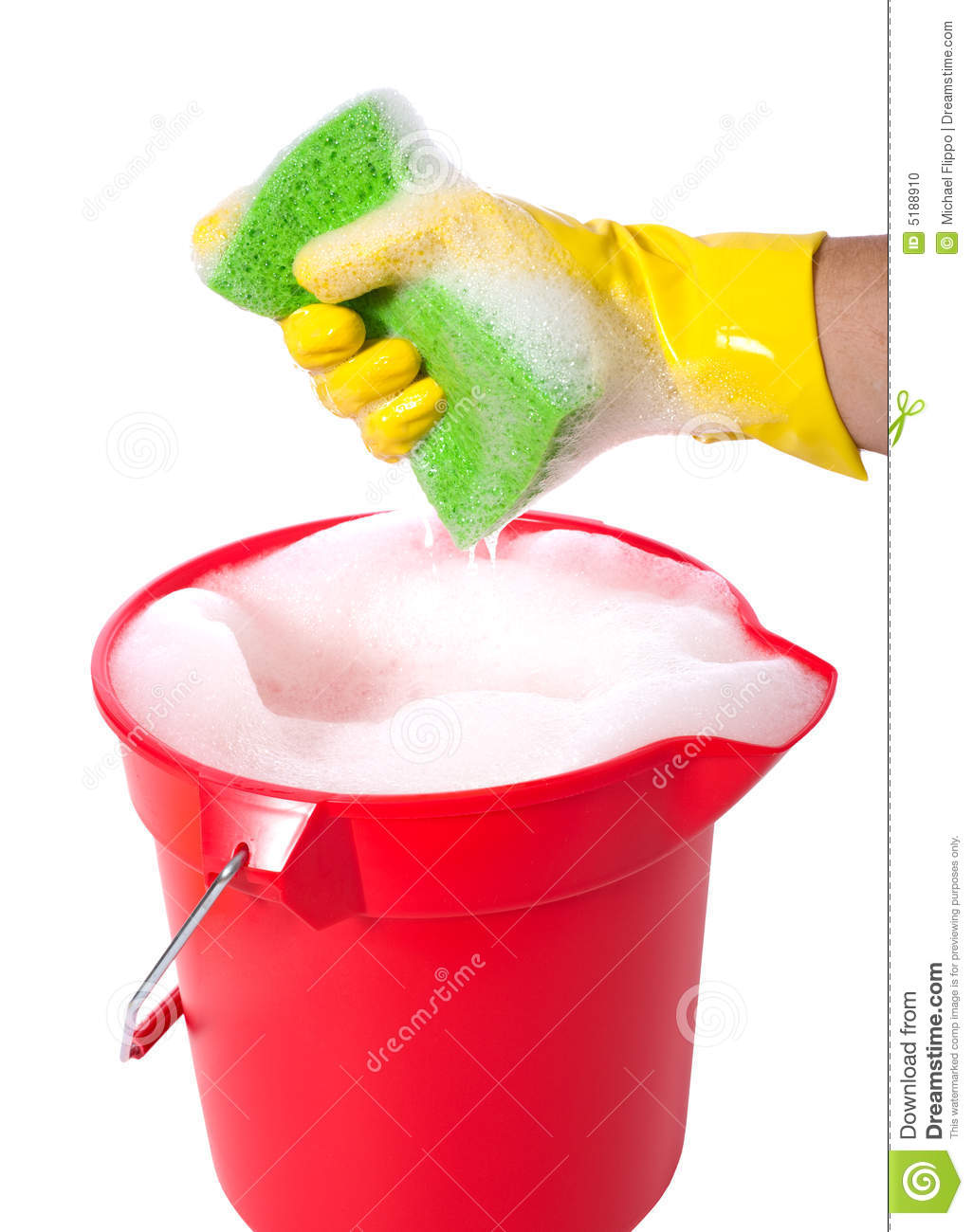 sudsy bucket or pale of soap with a hand holding a sponge. cleaning ...