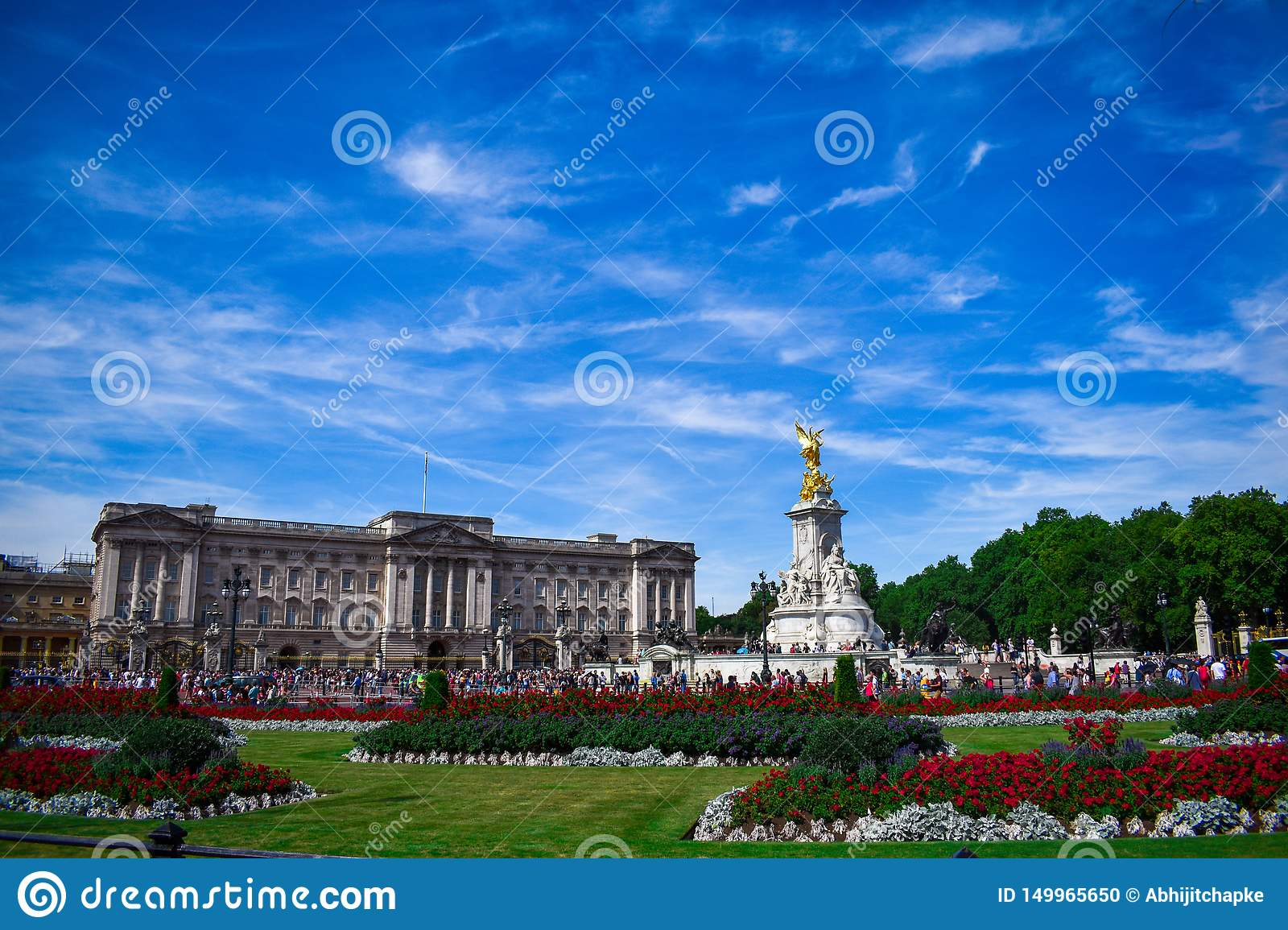 Buckingham Palace with Monument. Full view of Buckingham Palace during sunrise.Buckingham palace and the Victoria memorial with a