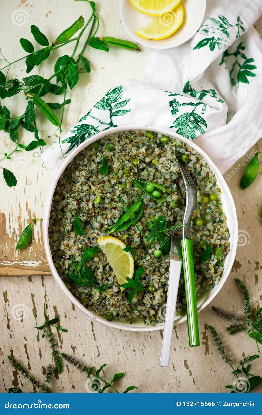 Buckweat and green peas risotto vegeterian dish