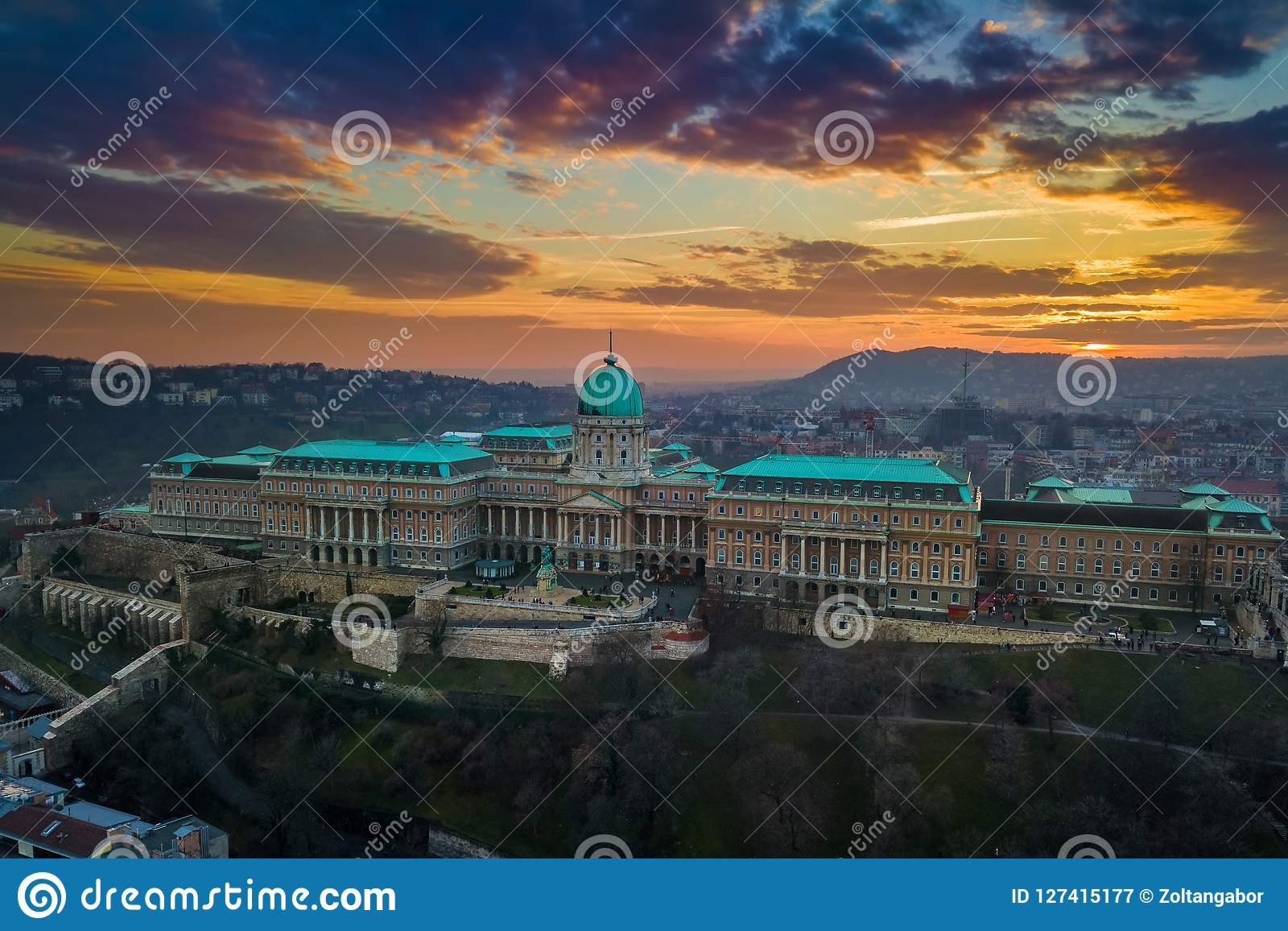 Budapest, Hungary - Aerial panoramic view of the famous Buda Castle Royal Palace at sunset with amazing colorful sky