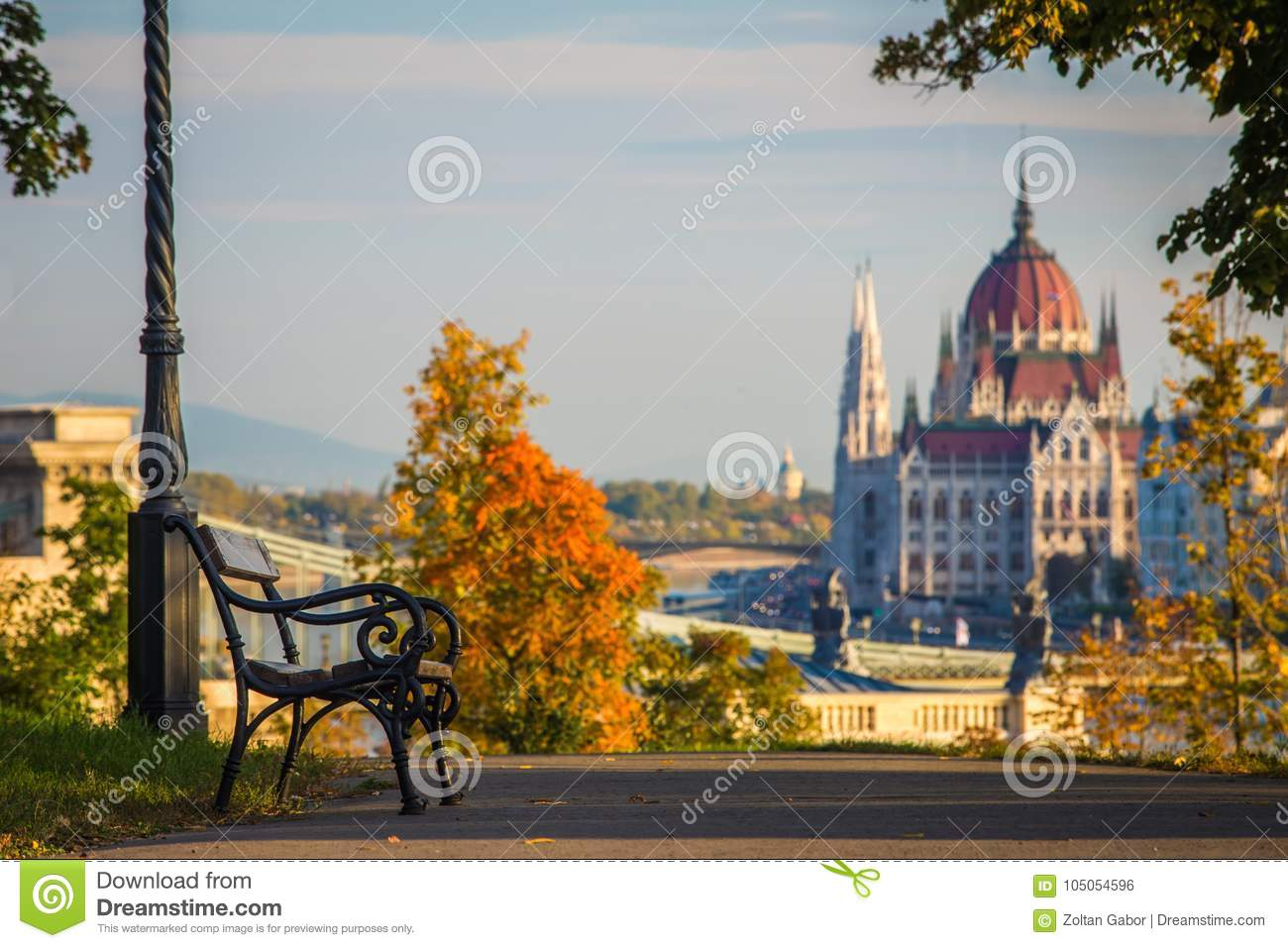 Budapest, Hungary - Bench and autumn foliage on the Buda hill with the Hungarian Parliament
