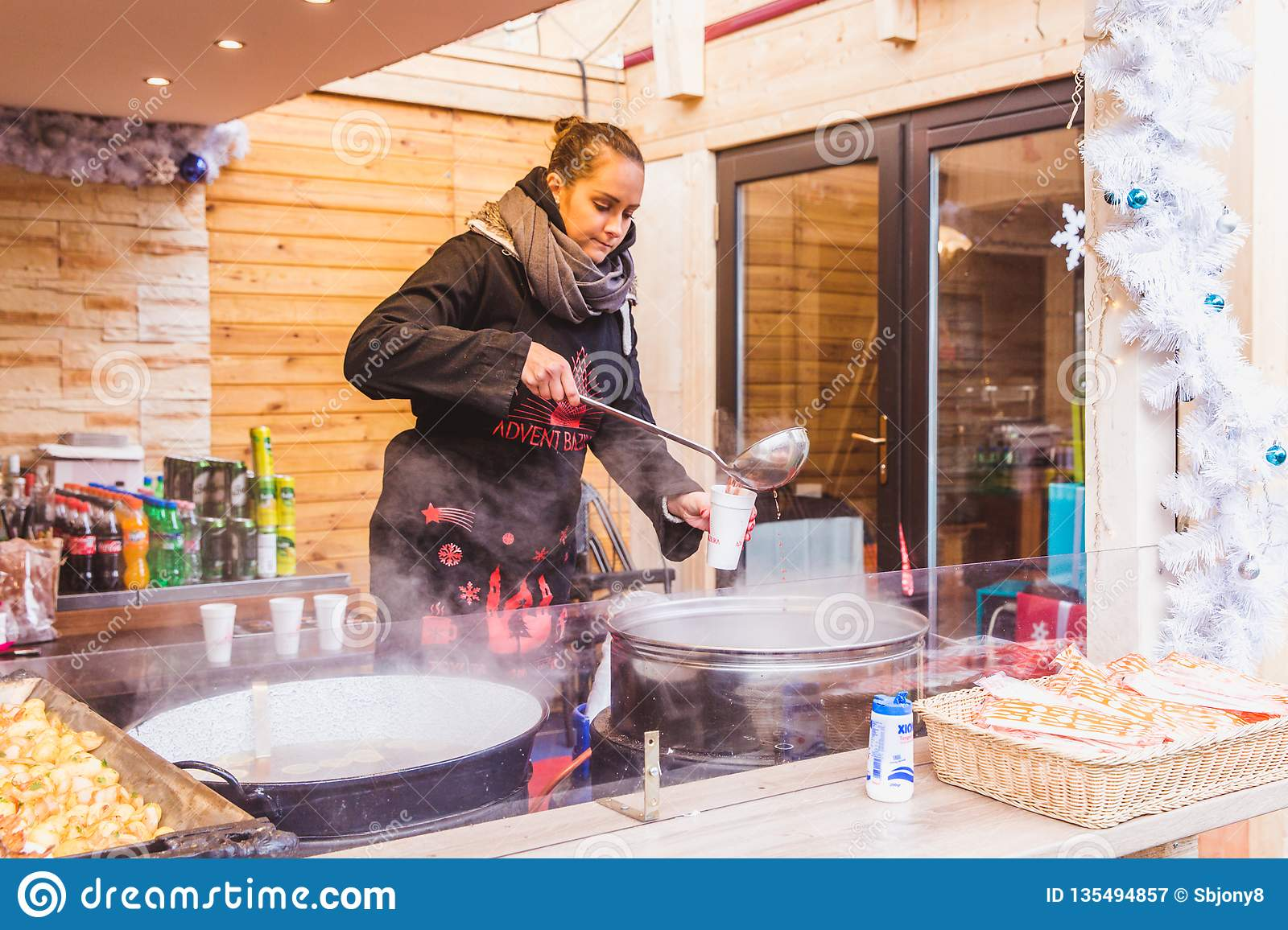BUDAPEST, HUNGARY - DECEMBER 19, 2018: Tourists and local people enjoying the beautiful Christmas Market at St. Stephen