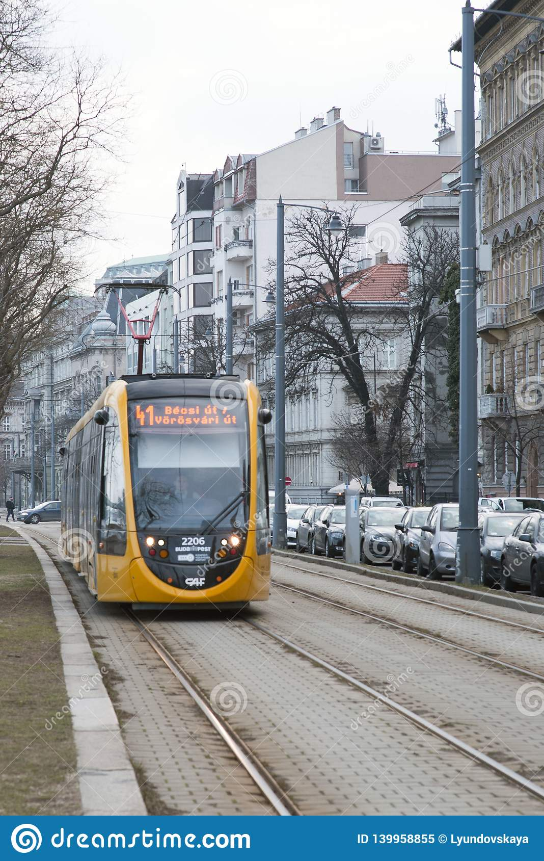 Budapest, Hungary, February 13, 2019. Yellow cars of the Budapest tram arrive at the stop.