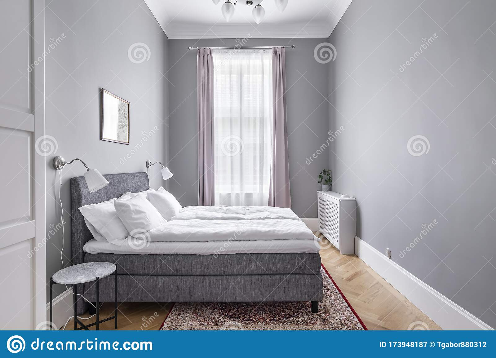Budapest Hungary May 30 2019 Modern Minimal Grey Bedroom With Pastel Lilac Curtains And Red Persian Rug From Side View Editorial Photography Image Of Cosy Bedding 173948187