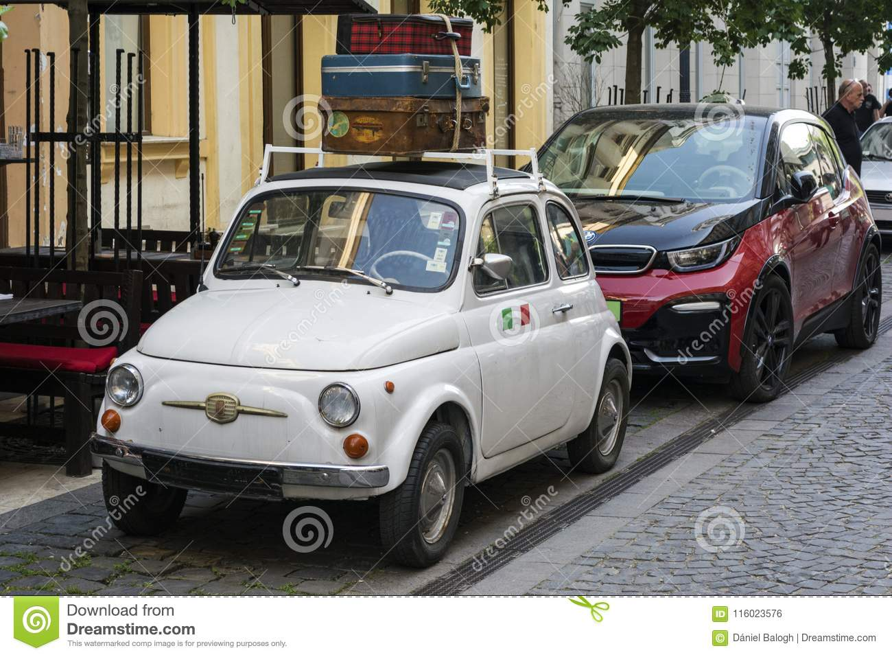 BUDAPEST, HUNGARY - MAY 5, 2018: Veteran fiat 500 meets modern bmw i3. Technology and tradition. The past and the future.