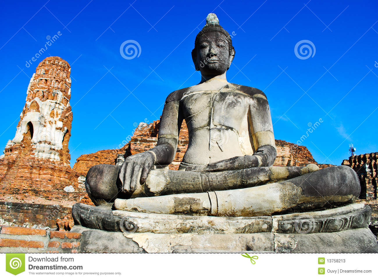 Buddha in Ancient Ayutthaya on clear sky, Wat Mahathat. Thailand.