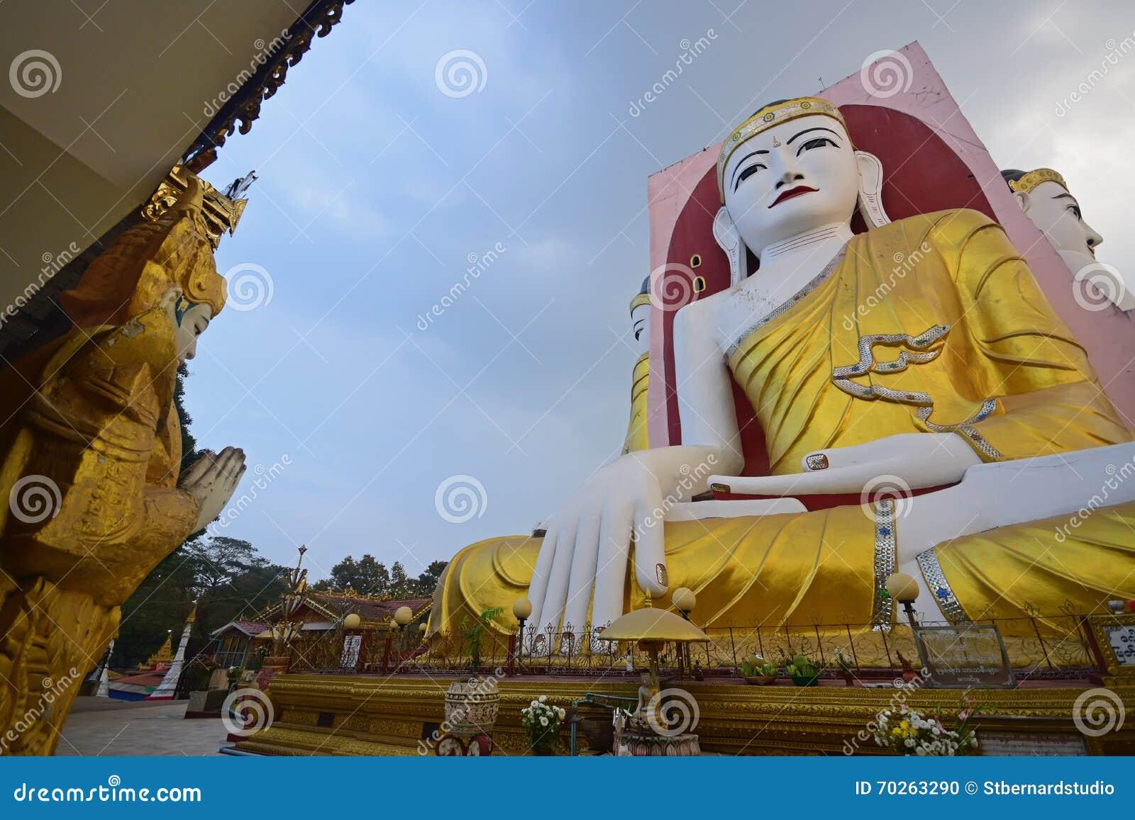 Buddha of Kyaik Pun Pagoda Bago meditating with roof on the left