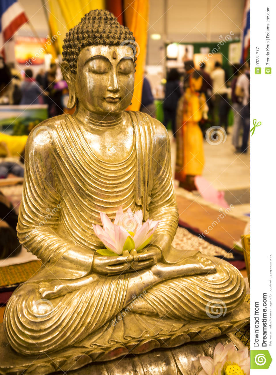 Buddha with lotus flower at the festival of the orient in rome italy buddha with lotus flower at the festival of the orient in rome italy mightylinksfo