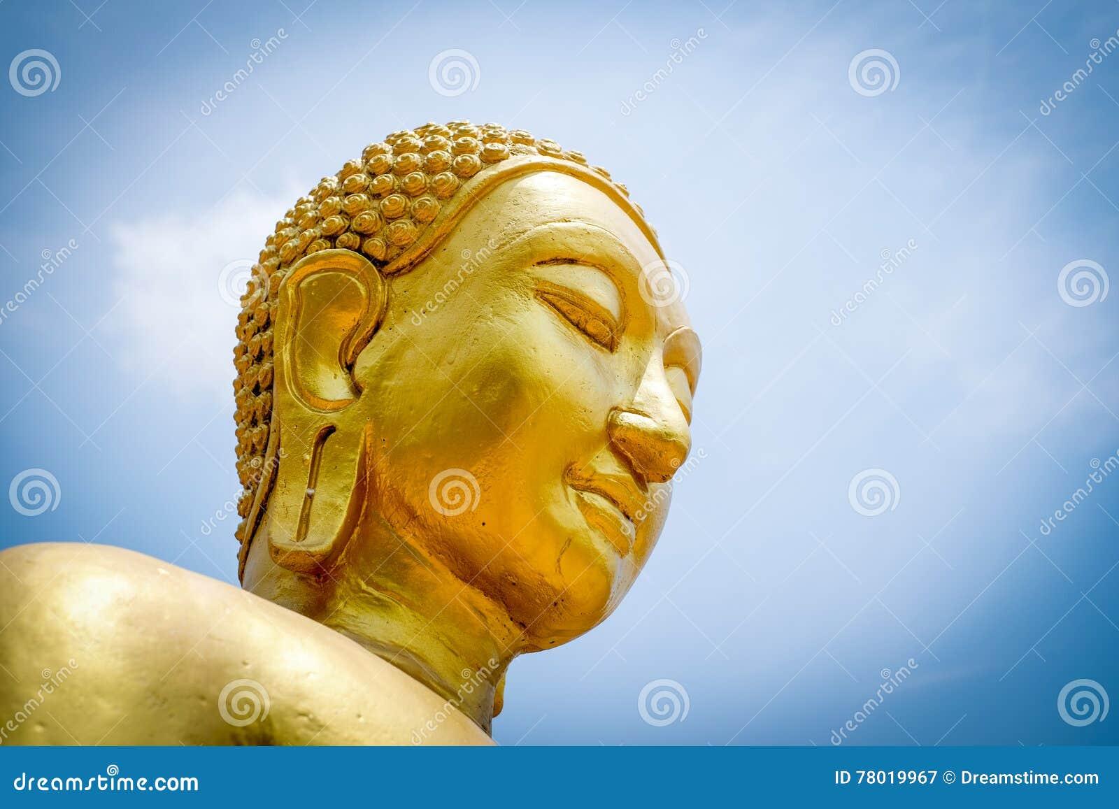 Buddha statue on blue sky