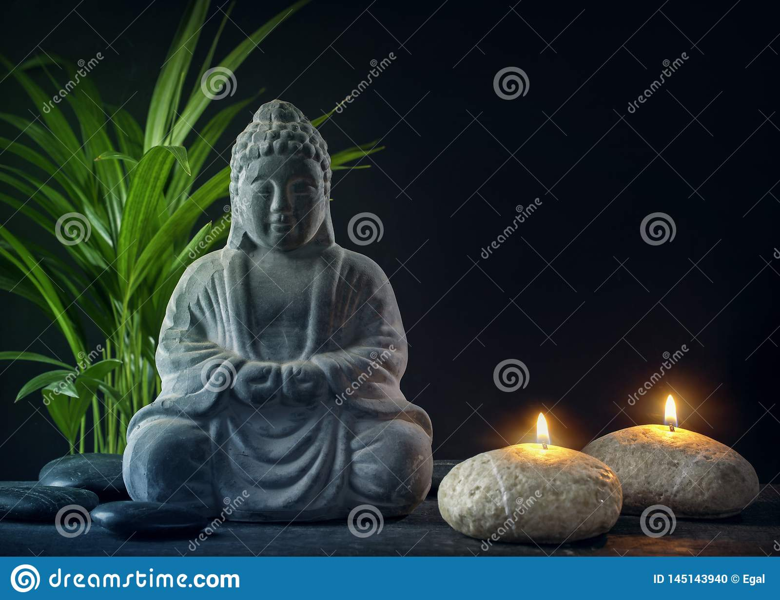 Buddha statue ,towels and candles