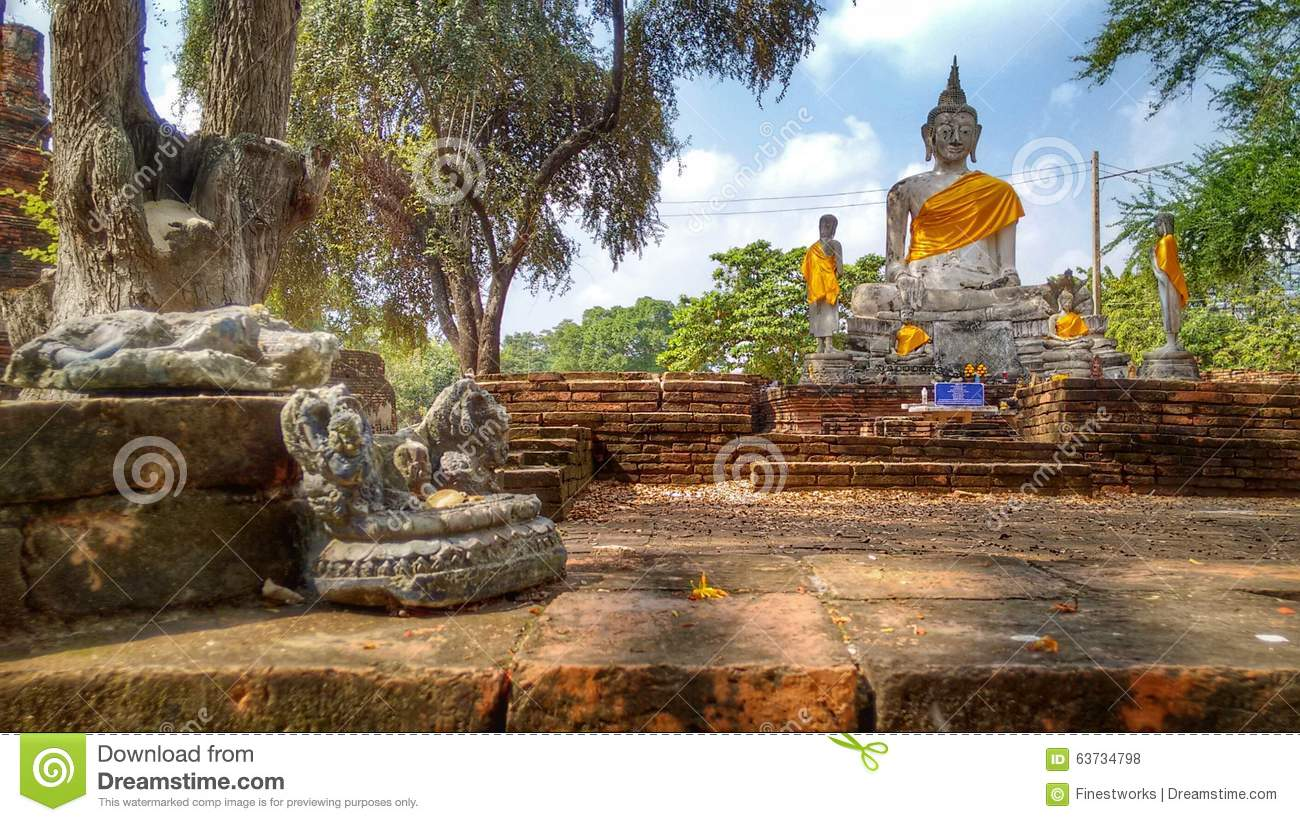 Buddha statues in an old historical temple in Ayutthaya in Thailand