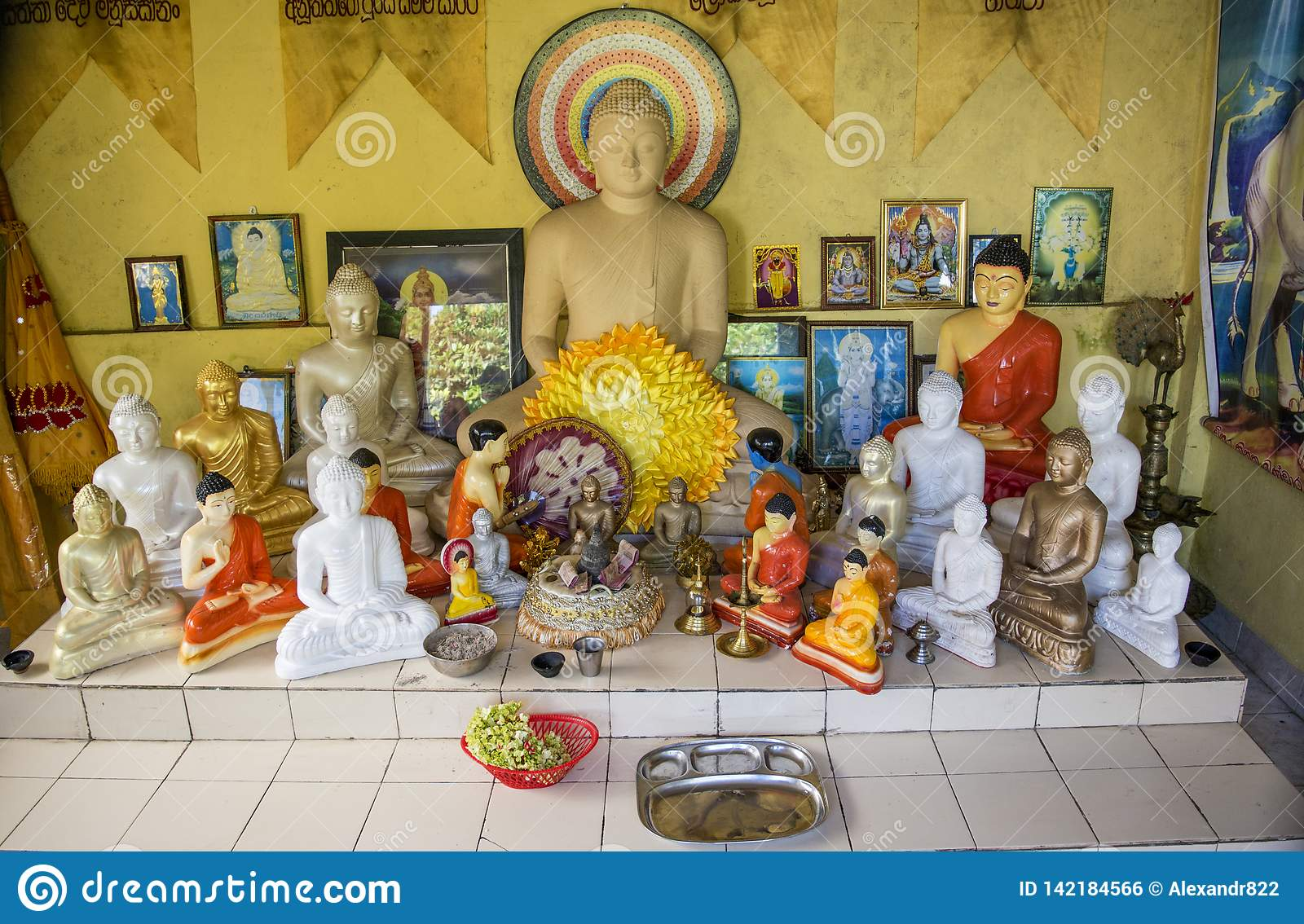Buddhist altar with buddhist statues in the temple