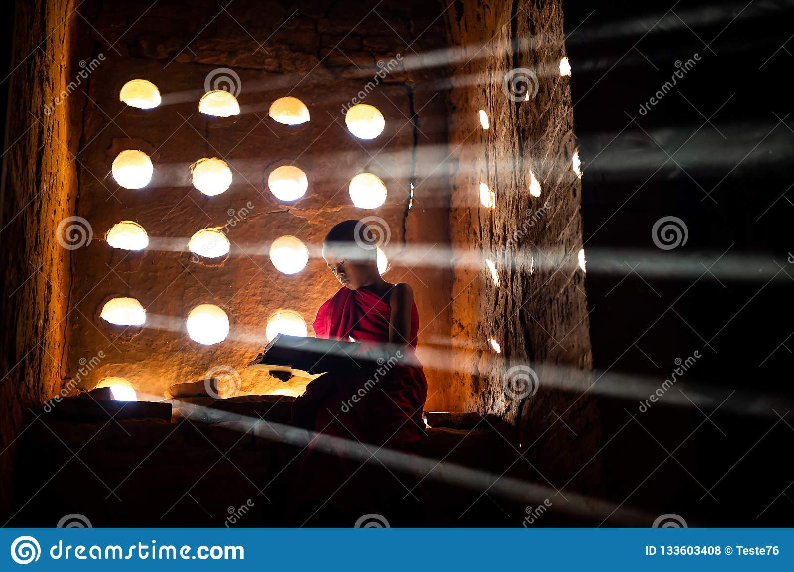 Buddhist monk praying. Special light