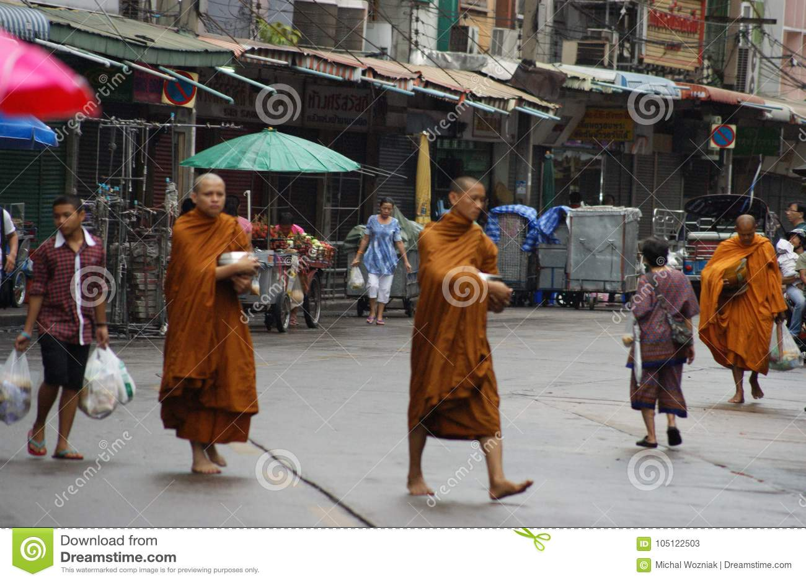 Buddhist monks alms on Bangkok`s streets