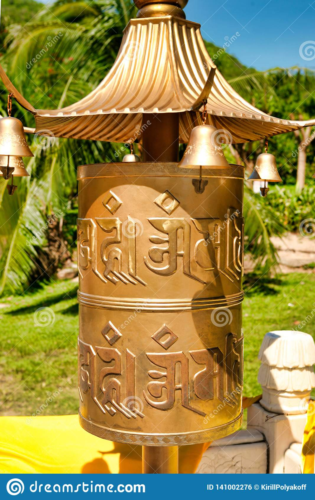 Buddhist Prayer Wheels In Front Of The Temple Jade-gold