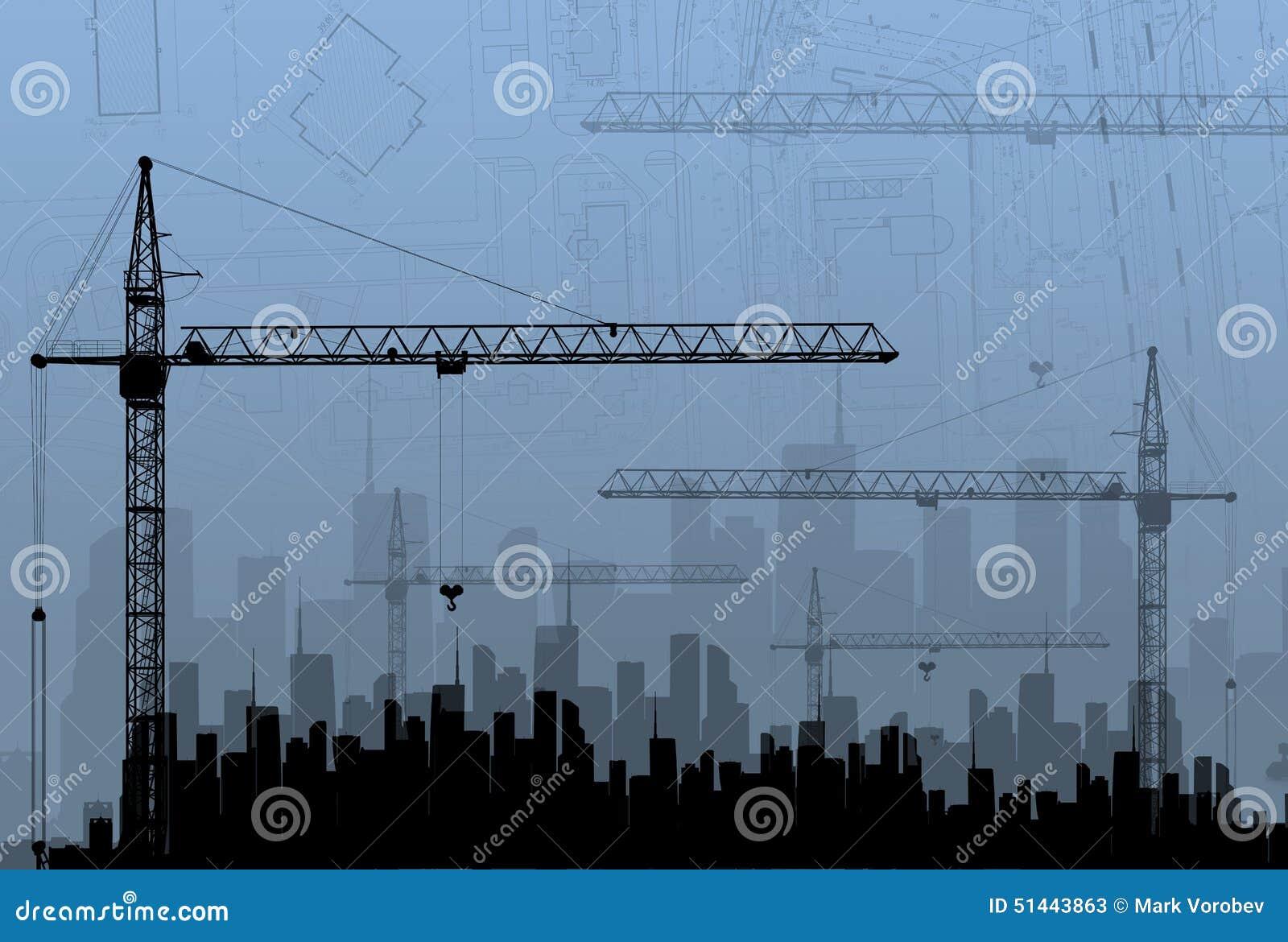 Budowa żurawie na tło budynkach