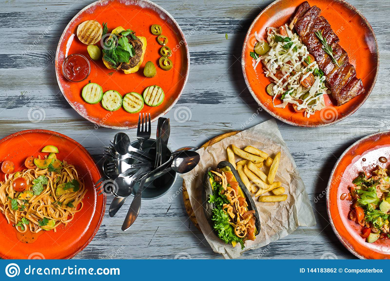 Buffet Food Grill Meat Lunch Restaurant Menu Banquet Concept Hot dog, barbecue pork ribs, steak, Carbonara paste and crab salad.