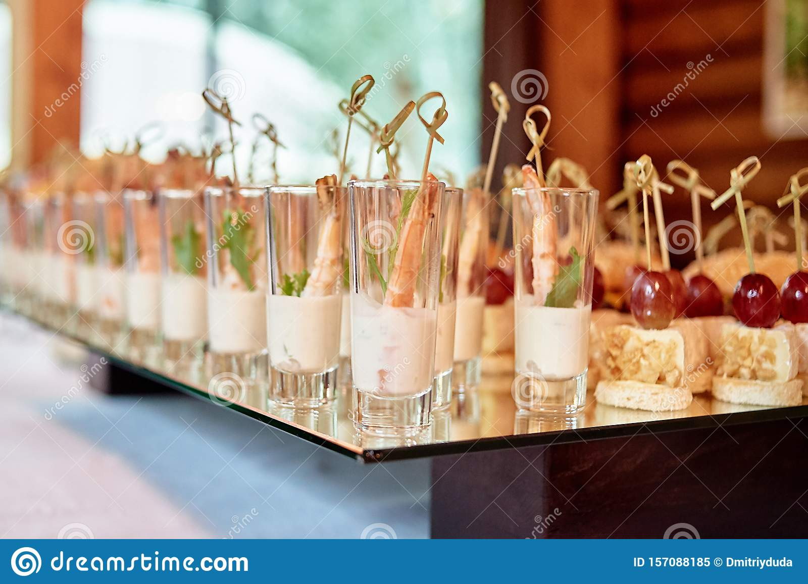 Buffet Table With Snacks Canape And Appetizers At Luxury Wedding