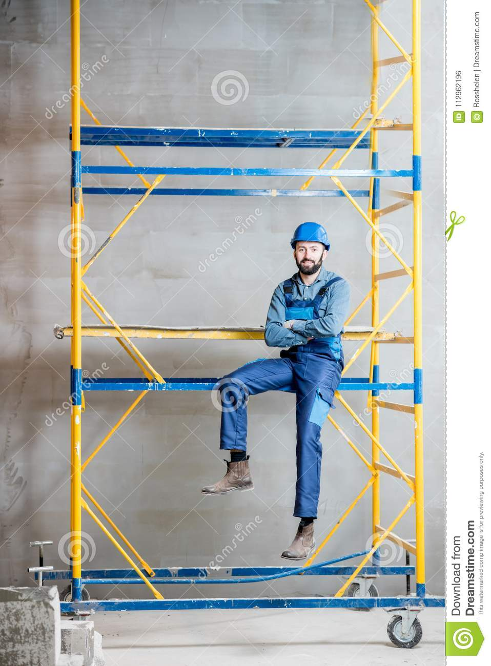 Builder on the scaffolding indoors