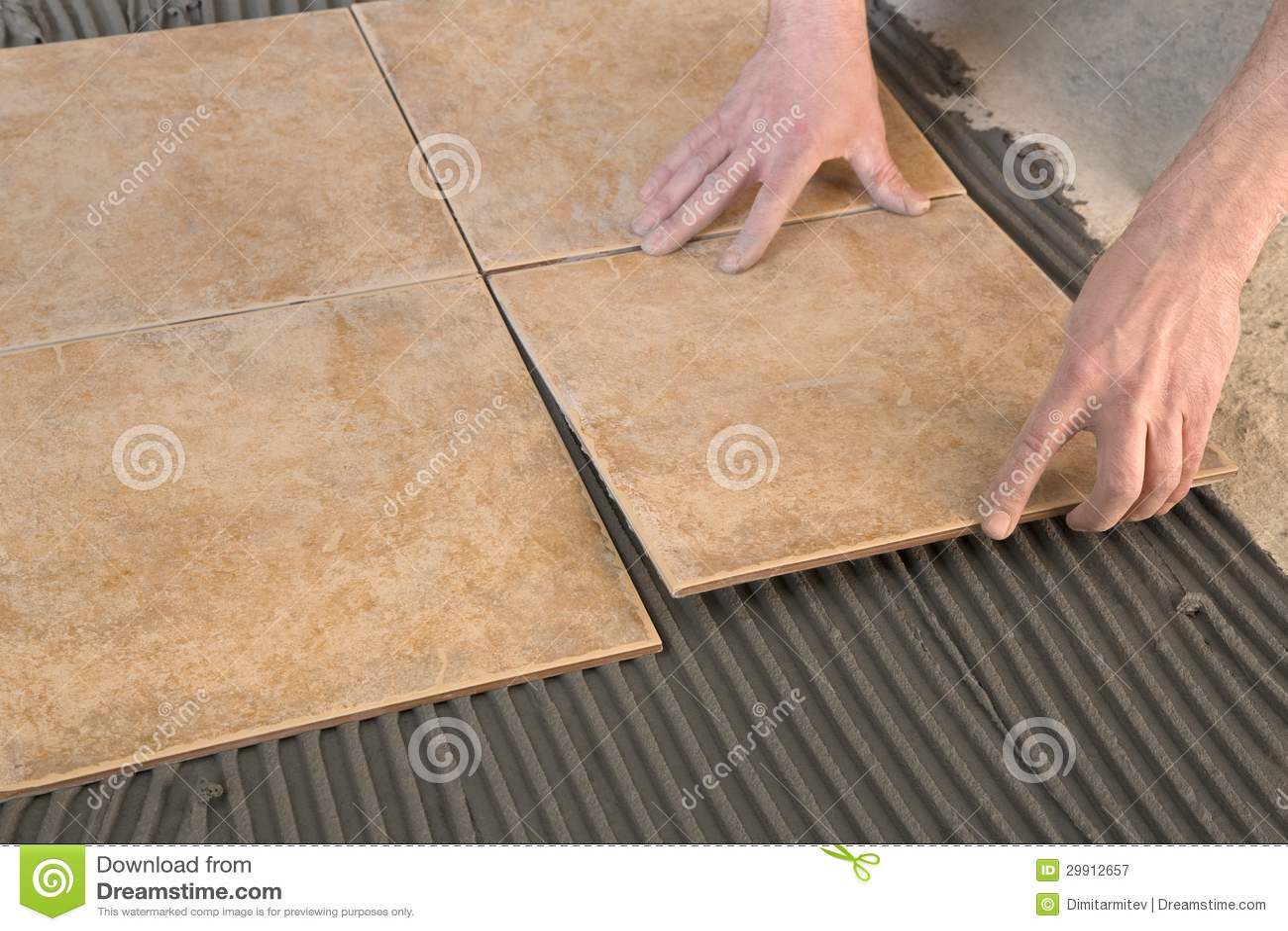 Builder floor tiles installed royalty free stock for Builder s pride flooring