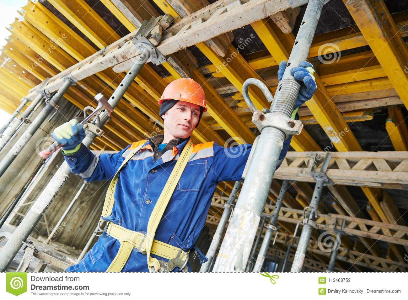 Builder installing or dismantling pole support for concrete monolithic formwork at housebuilding
