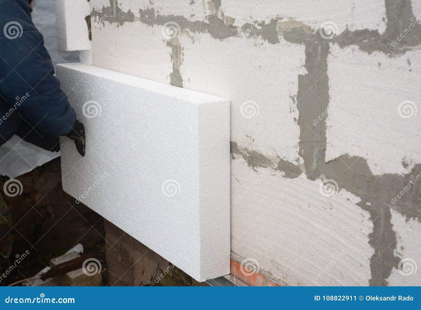 Builder Installing Rigid Styrofoam Insulation Board For