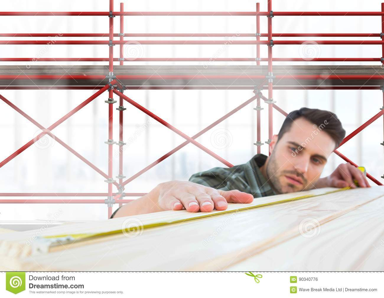 Builder measuring wood in front of 3D scaffolding