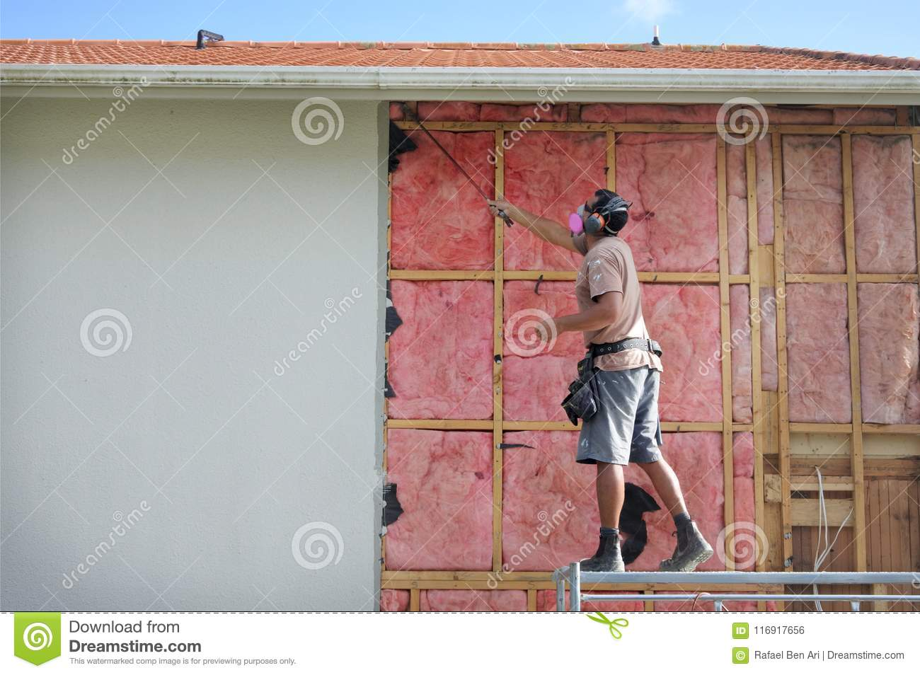 Builder Removing Old Fiberglass Wall InsulationHome Improvement Companies Traded Asbestos Insulation For After Finding Out The Harmful Effects