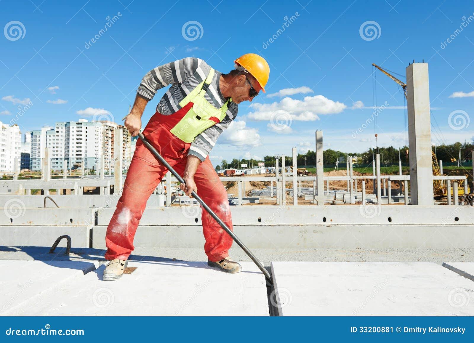 Builder worker installing concrete slab stock image for Builder floor