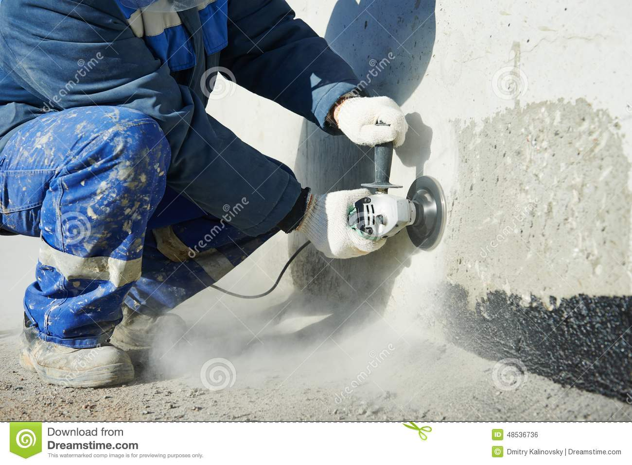 Buildings In A Cement Grinding Mill : Builder working with cutting grinder stock photo image