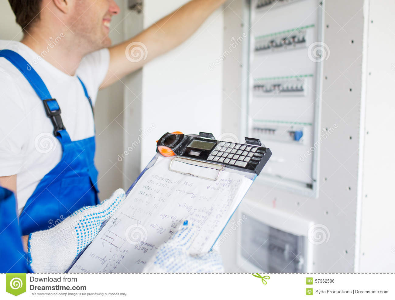 Builders With Clipboard And Electrical Panel Stock Photo