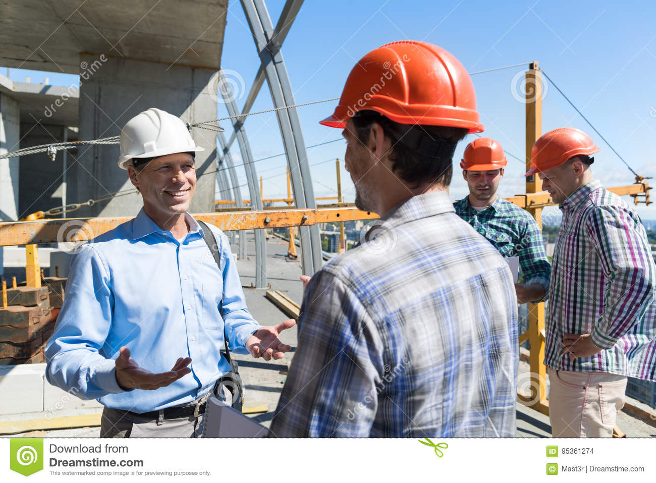 Builders meeting on construction site architect talking for Builder contractors