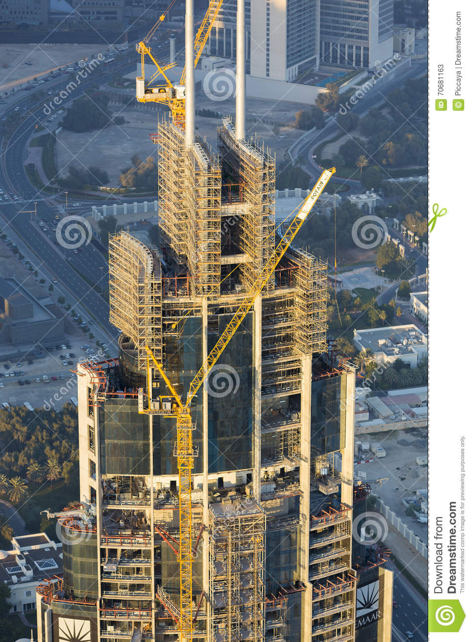 building construction site with crane in downtown dubai editorial stock photo image 70681163. Black Bedroom Furniture Sets. Home Design Ideas