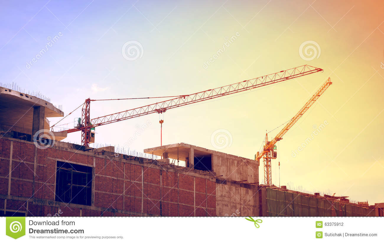 Large Construction Cranes : Building construction site with large cranes