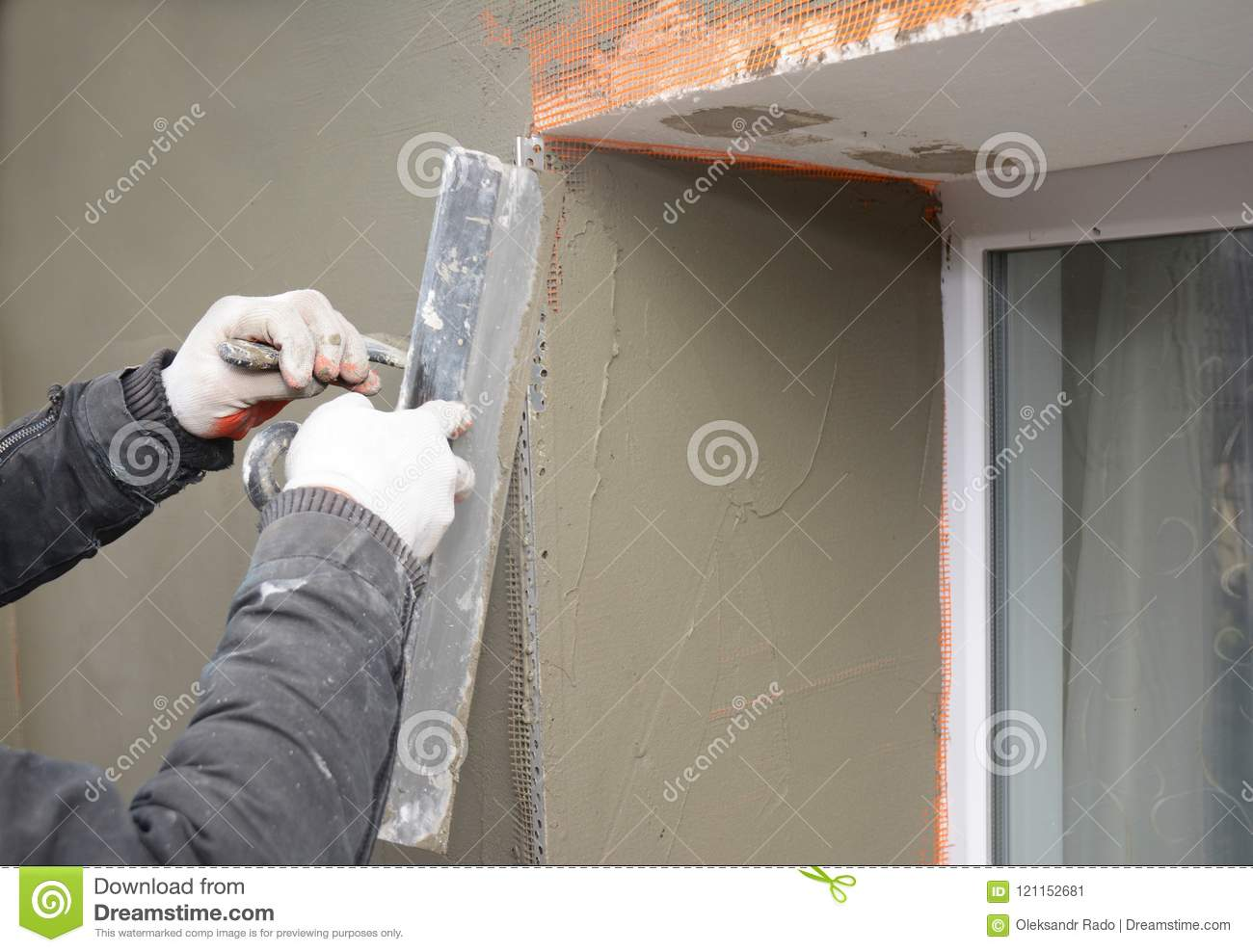Building Contractor Plastering Wall With Fiberglass Mesh