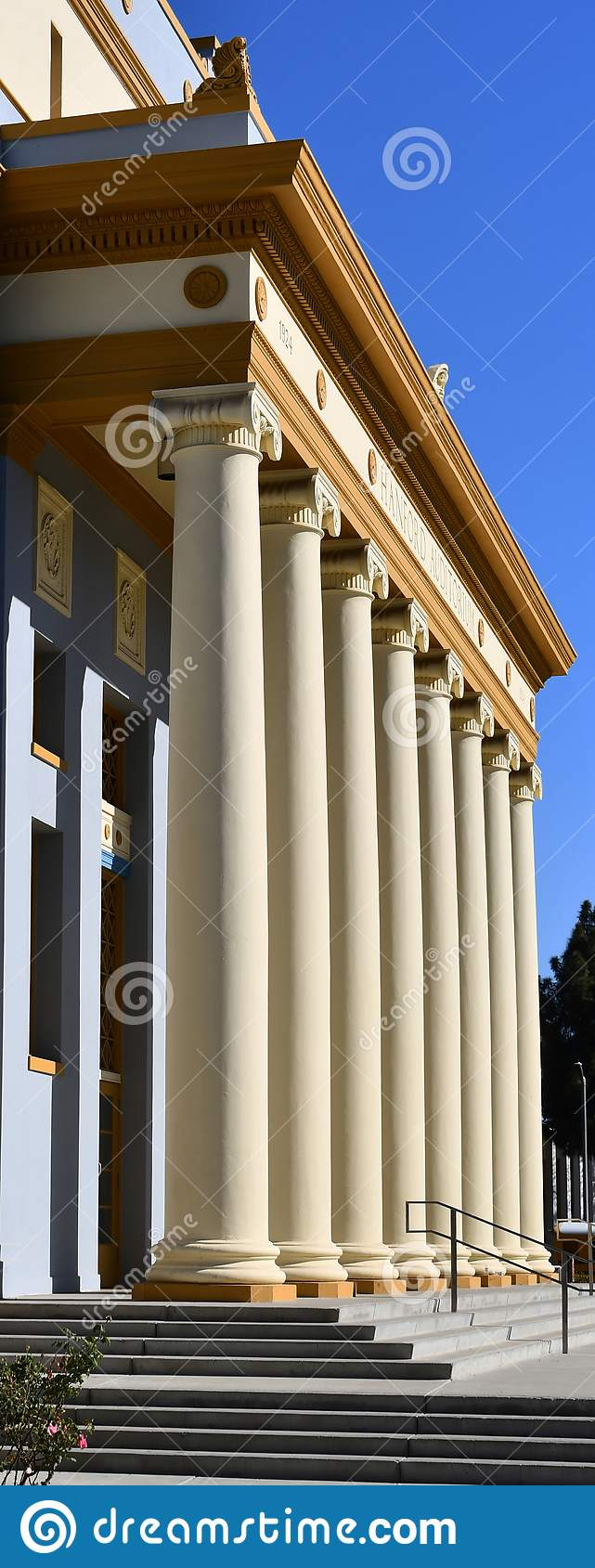 A building with corinthian columns in a row colonnade The neoclassical building style resembles a law court  courthouse,