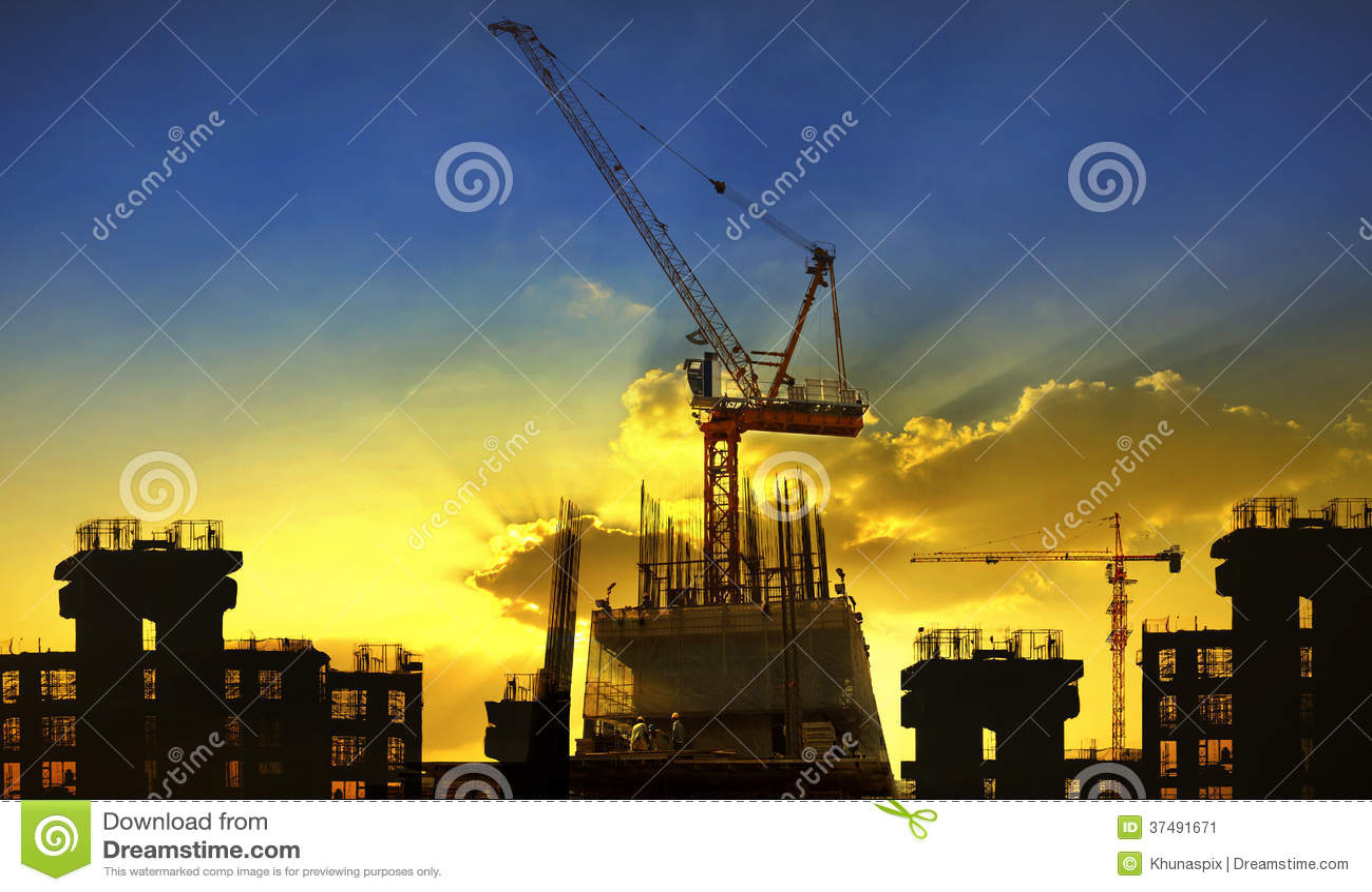 Building and crane construction site against beaut
