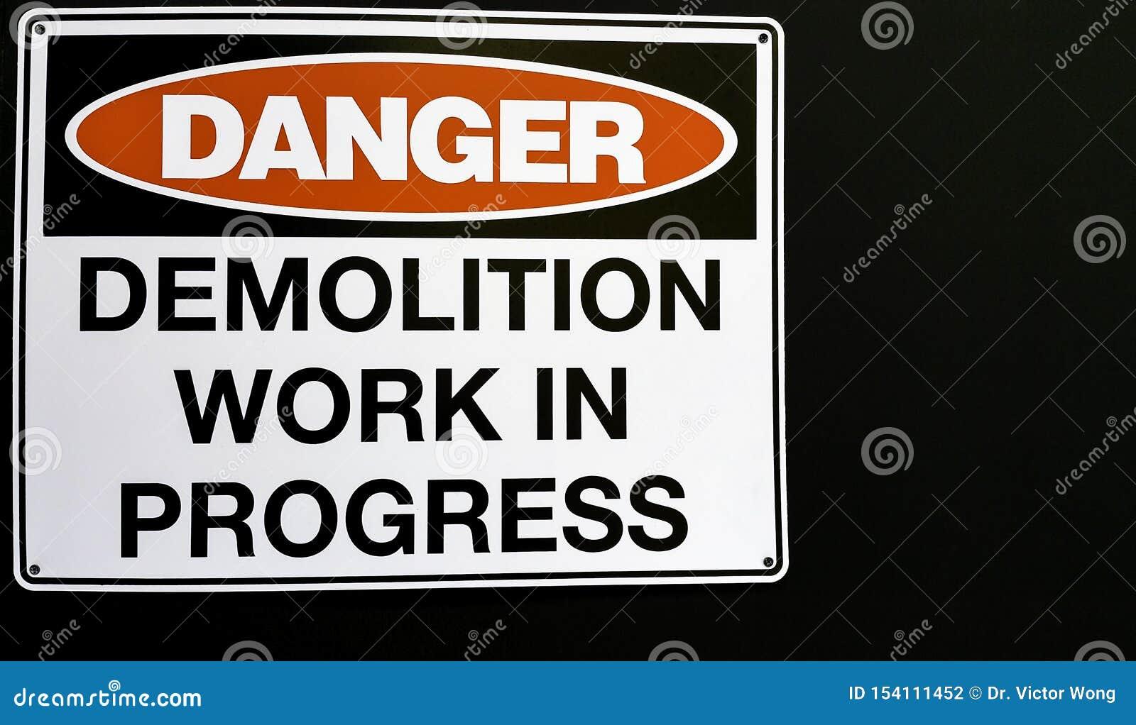 A building demolition sign